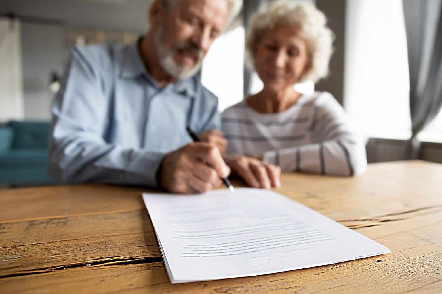 Couple signing enduring power of attorney document