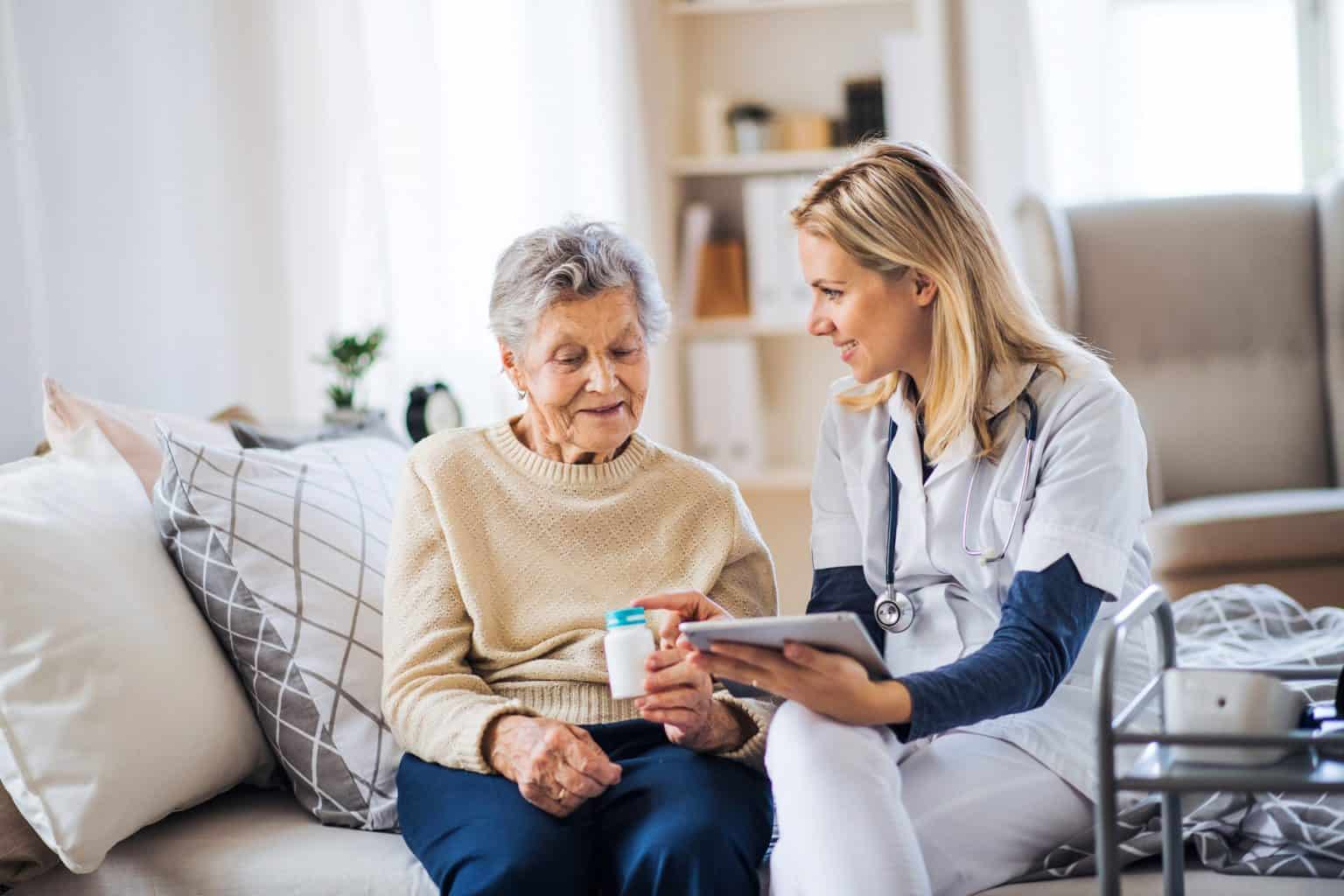 An elderly lady receiving aged care services at home as part of transitioning to aged care