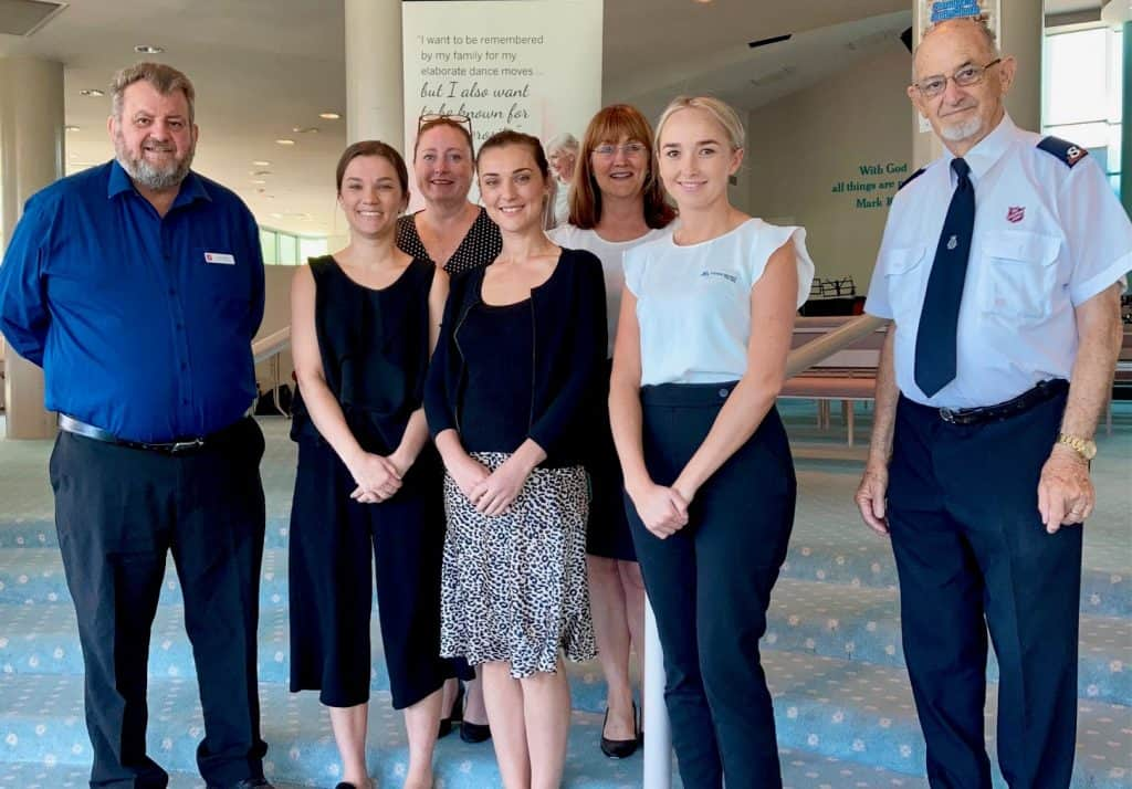 The Salvation Army Bequests Manager, Tony Welsh (left_ with Attwood Marshall Lawyers' Romy Garrett, Natalie Comerford, Rhiannon Garrett, Donna Tolley and Zoe Penman, with Salvation Army representative Ron Southall at the Gold Coast Salvation Army Temple, Southport on Tuesday 10th November 2020.
