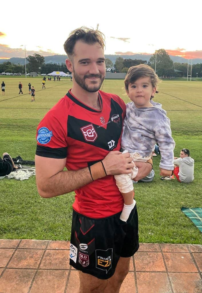 Henry Garrett with his nephew after a game at Redbacks Rugby League in May, 2021