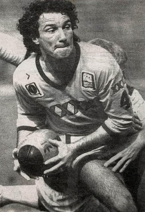 Jeff Garrett playing rugby