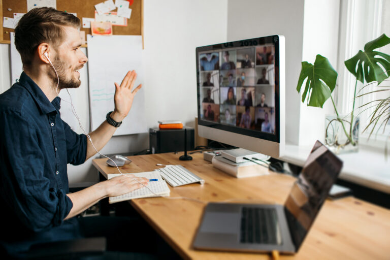 man working from home and connecting with colleagues via zoom