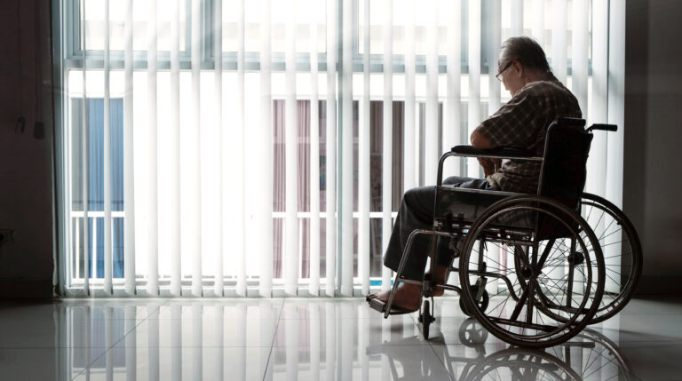 elderly man in aged care facility